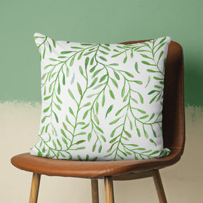 bright botanical throw pillow on chair