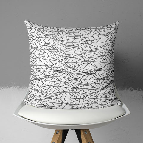 Modern Throw pillow in room sitting on chair
