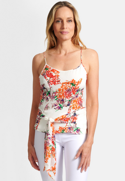 Model wearing silk orange and white flower printed halter top with long tie