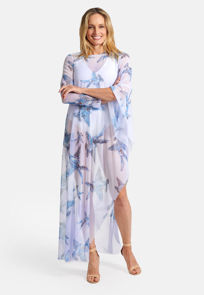 Model wearing mesh one sleeve lavender poncho with blue birds printed on it