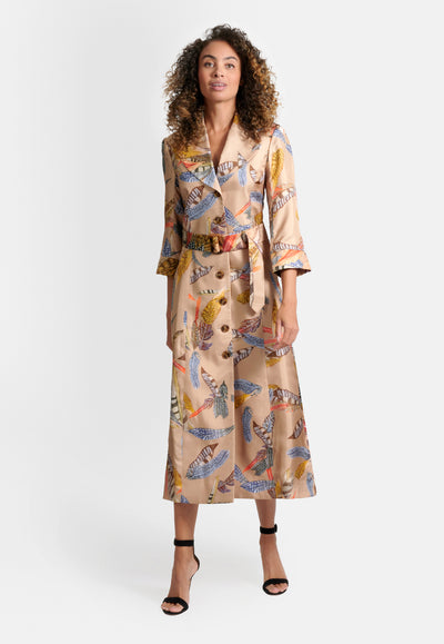 Model wearing trench coat silk dress with brown feather print