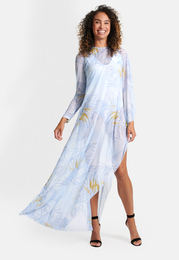 Model wearing yellow and blue feather printed mesh poncho
