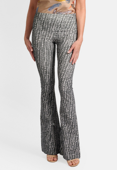 Model wearing black and white dotted stretch corduroy flare pants