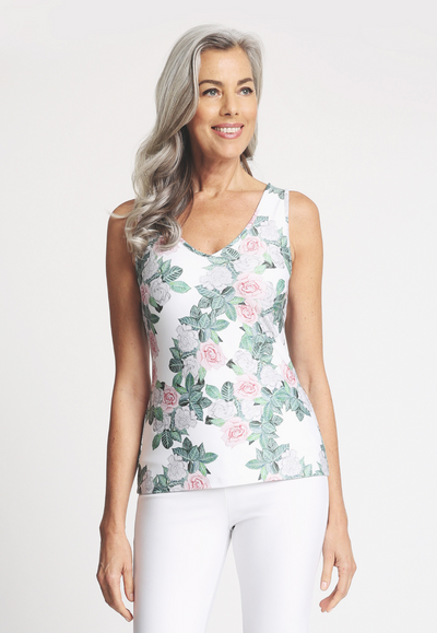 Model wearing gardenia flower printed stretch knit tank top