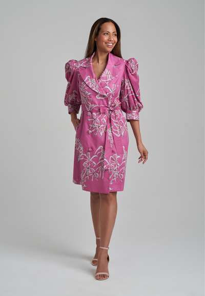 Woman wearing cotton puff sleeved dress jacket in watermelon spider lily print