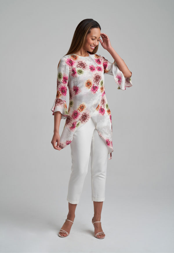Woman wearing silk asymmetrical blouse in dahlia flower print