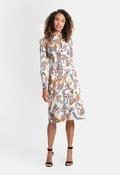 Model wearing cotton white feather printed shirt knee length dress with French cuffs