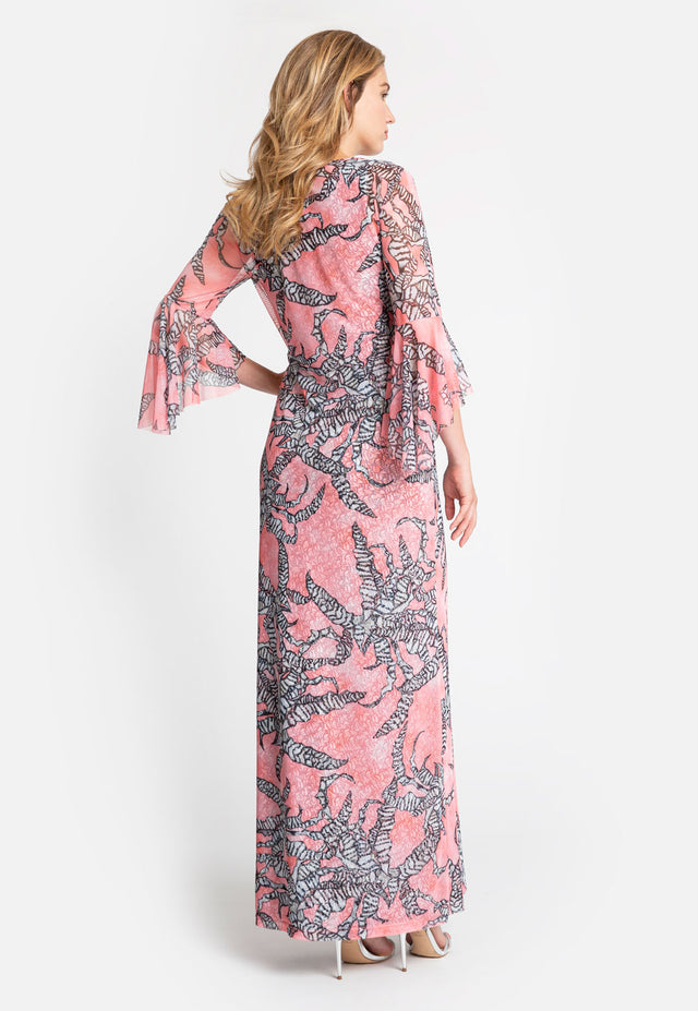 Model in quarter sleeve length printed pink floral dress