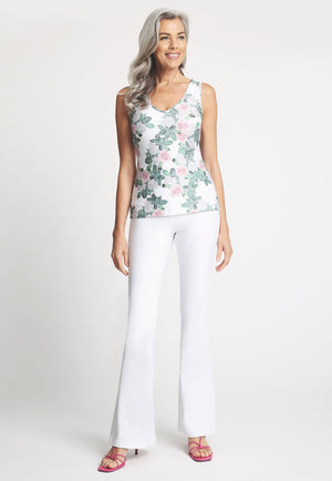 Model in gardenia printed tank top with white pant