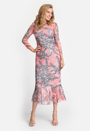 Model in long sleeve printed dress with ruffle bottom