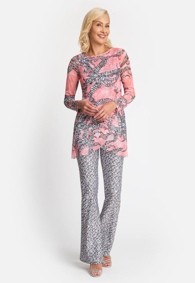 Model in long sleeve mesh pink floral top with black and white printed pants