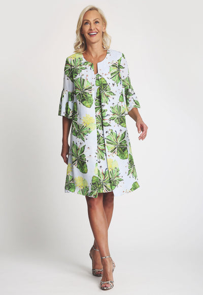 Silk three quarter sleeve green Lilly pad printed jacket over short silk lily pad printed dress