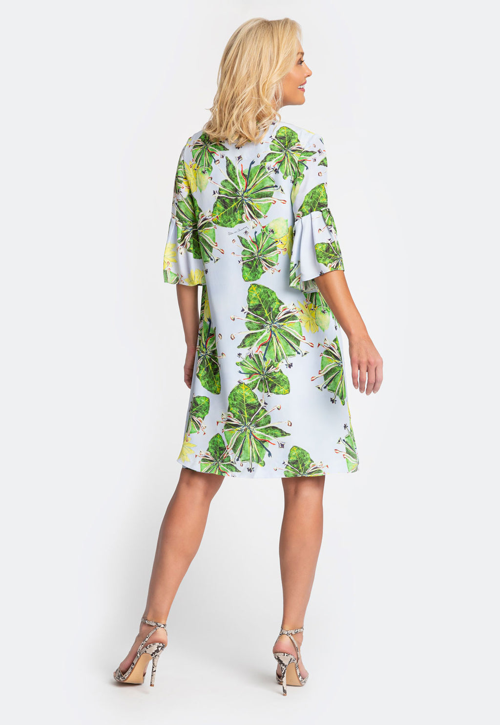 Model in knee length three quarter sleeve gardenia printed jacket with matching knee length dress