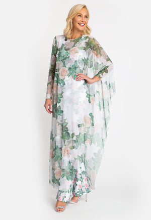 Model in gardenia printed poncho with one sleeve with matching pant underneath