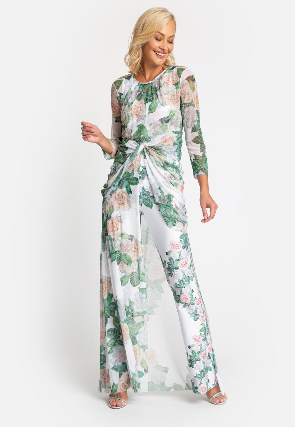 Model in long sleeve asymmetrical wrap dress with matching pant