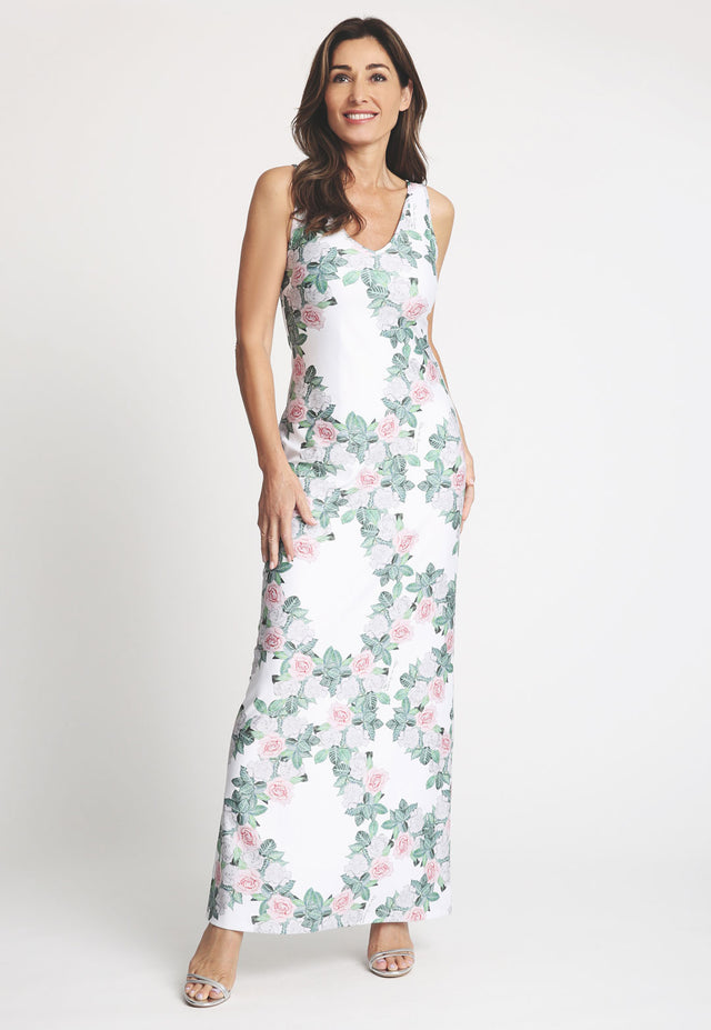 Model in long gardenia printed sleeveless dress