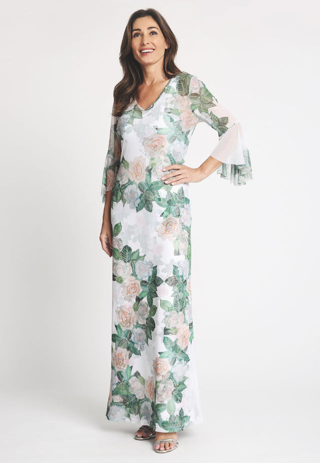 Model in long gardenia printed dress with ruffled sleeves