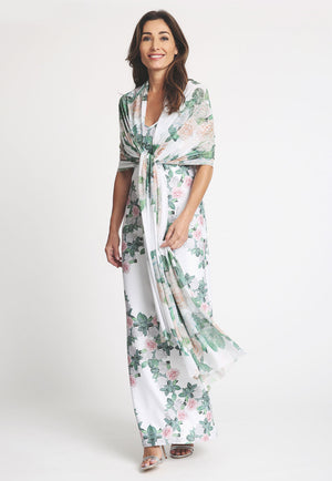 Model in long printed gardenia shawl over the shoulders with long matching printed dress