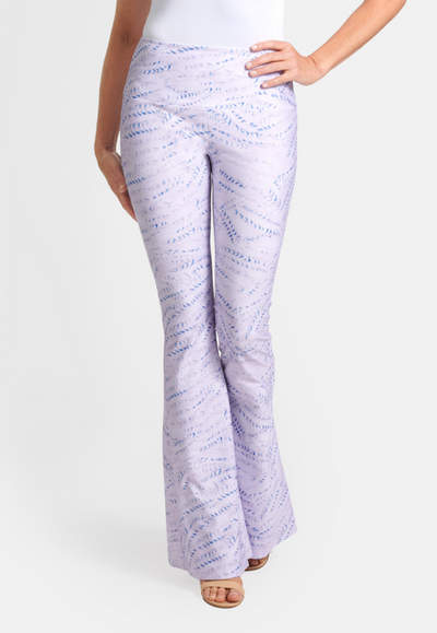 Model wearing lavender and blue track printed stretch knit pant
