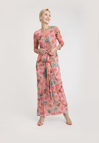 pink and orange floral printed mesh wrap dress layered over long pink and orange long stretch knit dress
