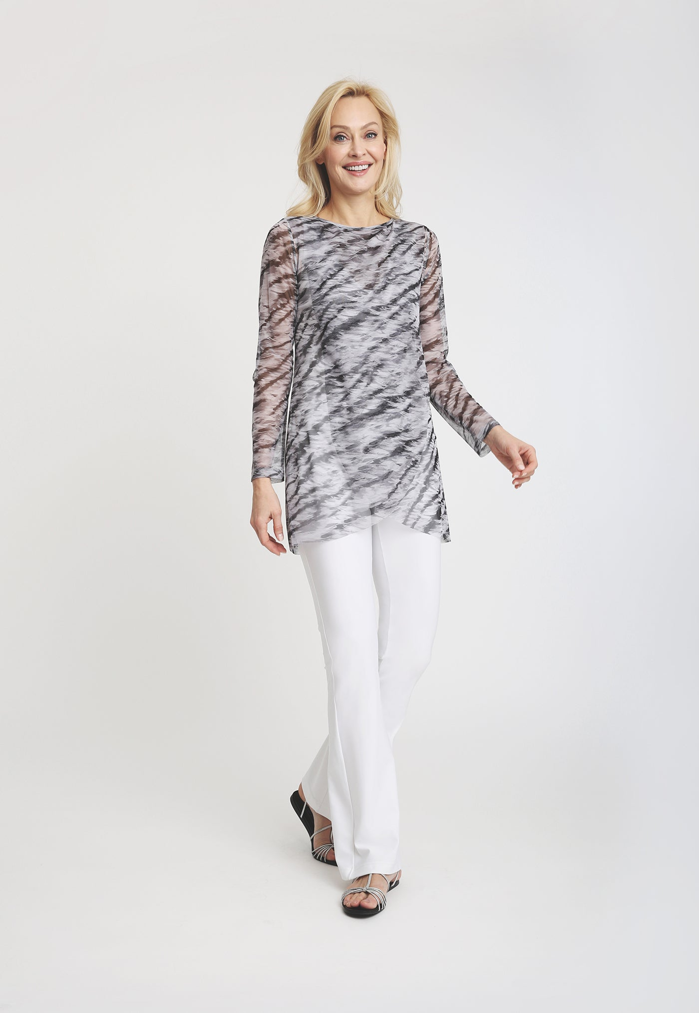 Long sleeve mesh drape top with black and white tiger print and white pant