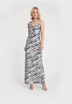 Model in long sleeveless black and white tiger print dress