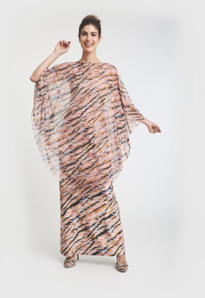 Model in triangle cut mesh poncho with pink and black tiger print, over matching dress