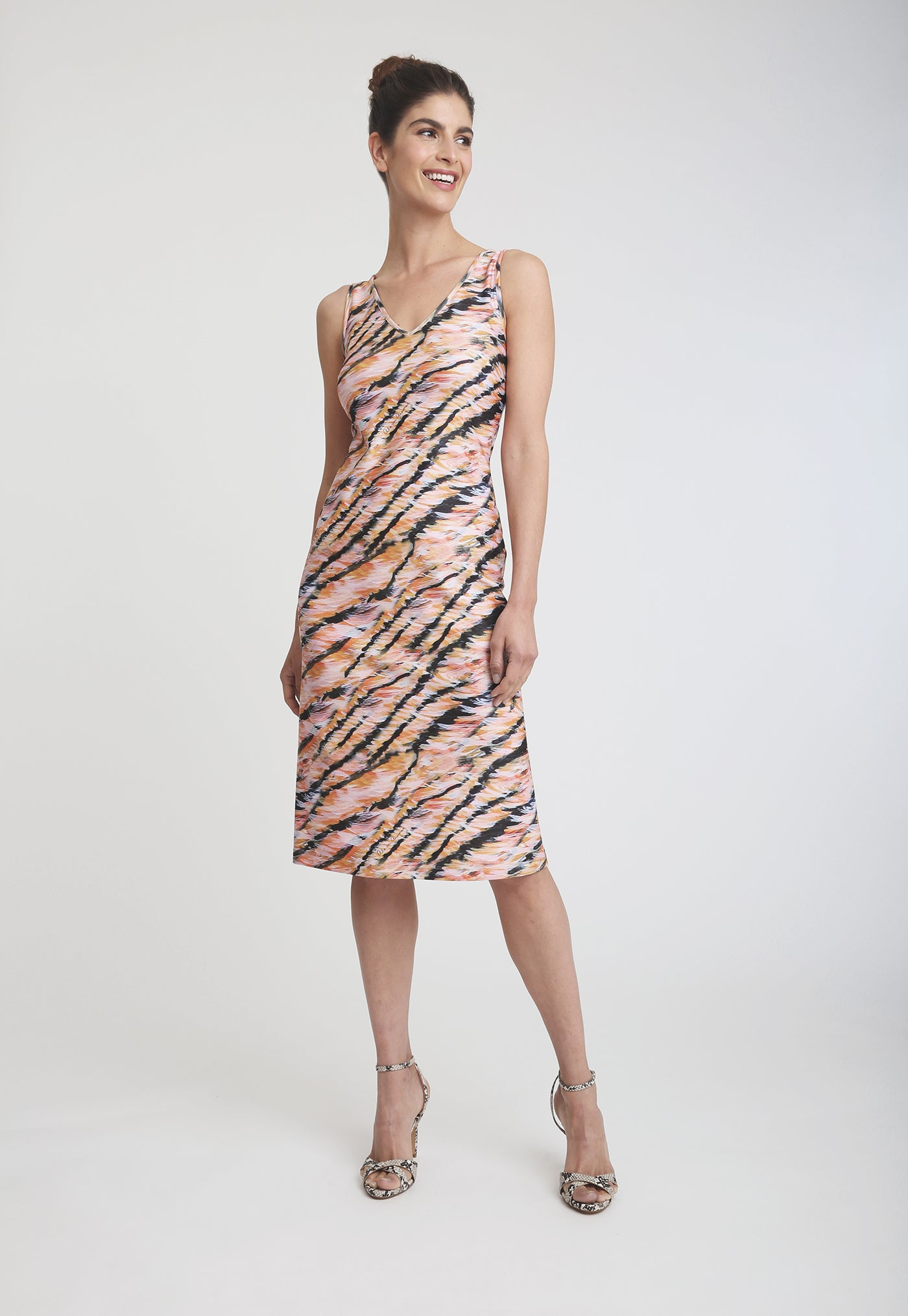 Model in pink and black tiger print knee length sleeve less dress