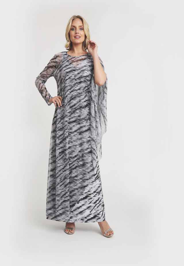 Model in long mesh black and white tiger print poncho with one sleeve