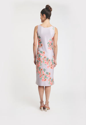 Model in knee-length sleeveless dress with pink floral print