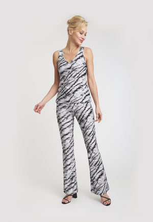 Model in a black and white tiger print pant with matching tank top