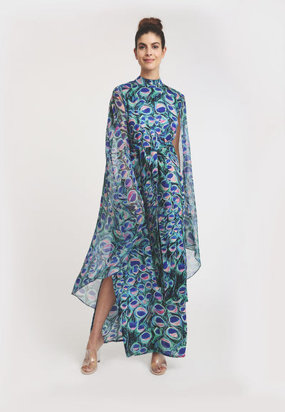 model wearing high neck silk peacock printed dress with sheer shawl attached