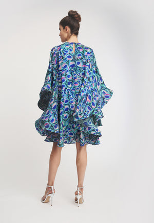 Model wearing peacock printed dress with bellowed ruffle sleeves