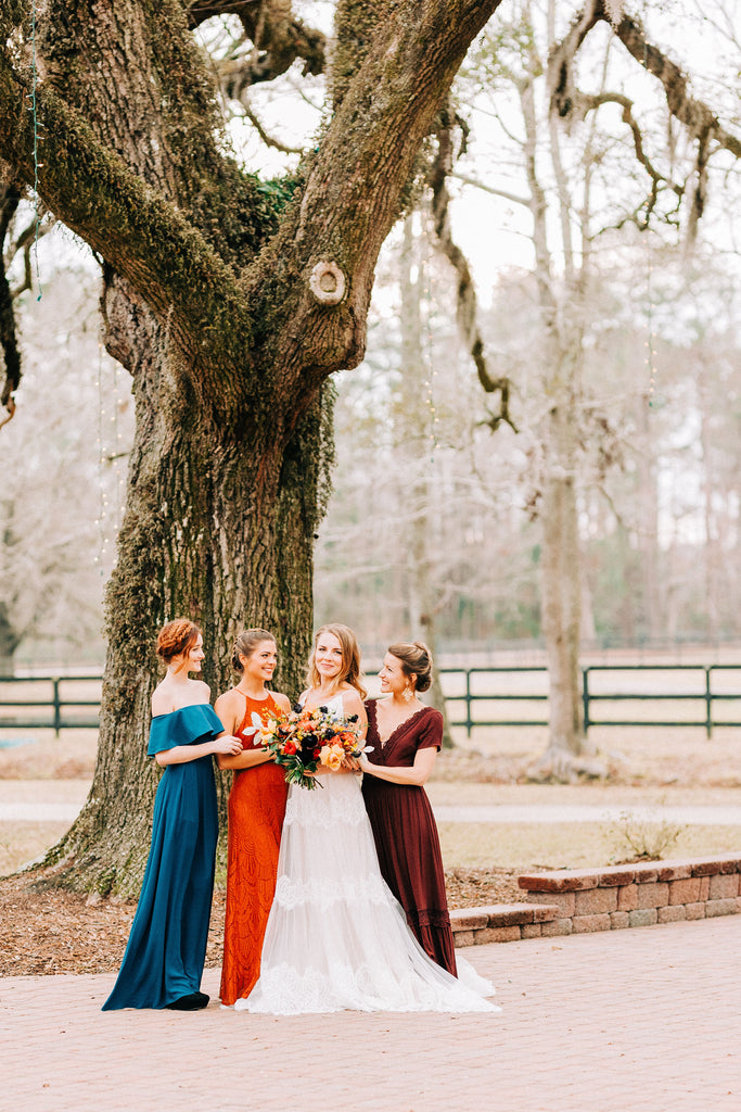 Bride and bridesmaids at Old Homestead Farm in Rocky Point, NC. Photo by Chelsea Allegra Photography.
