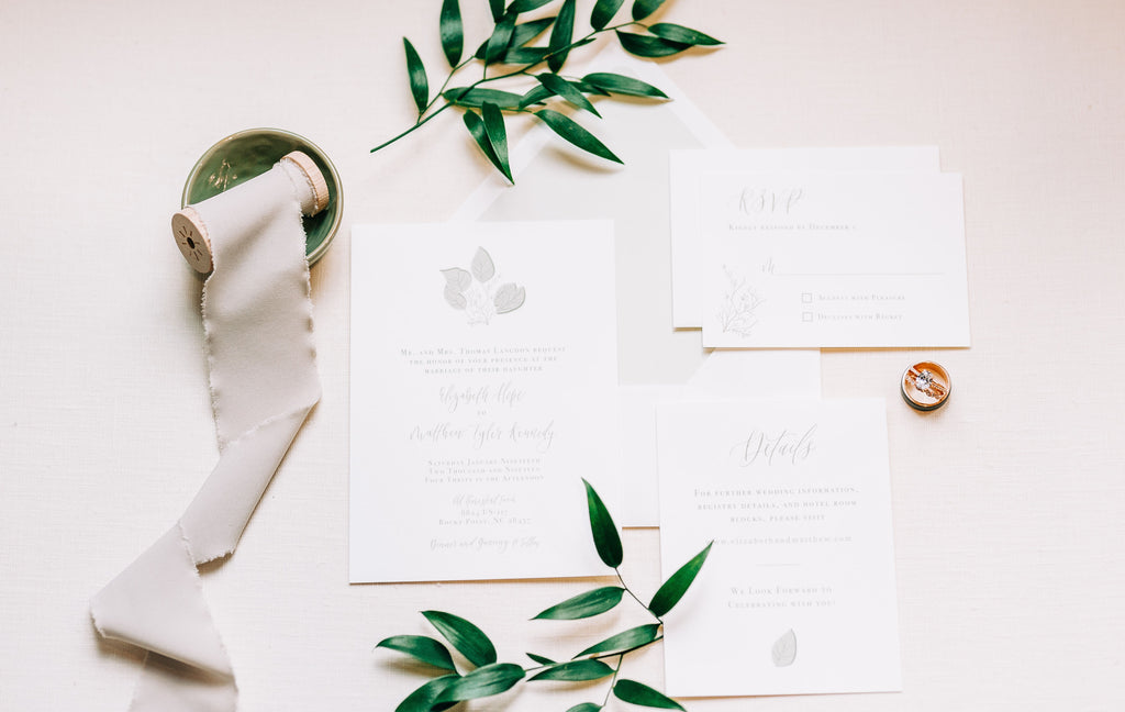 Rustic Boho styled custom wedding invitation suite by Ivy + Linen Design Co. with simple greenery and calligraphy details
