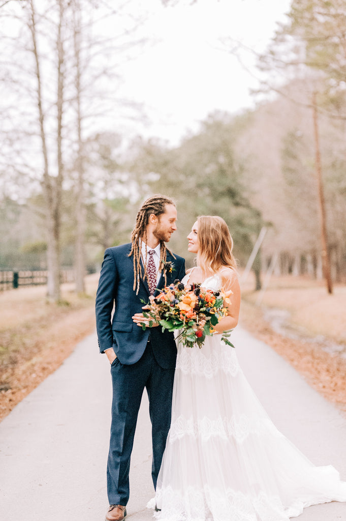 Gorgeous bride and groom photo from styled photo shoot at Old Homestead Farm in Rocky Point, NC. Photo by Chelsea Allegra Photography.