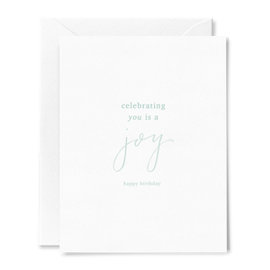 Celebrating You is a Joy hand lettered folded birthday card on linen cardstock