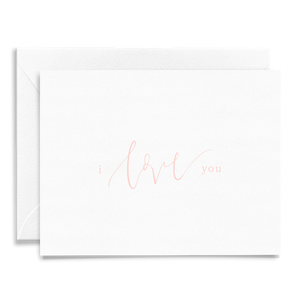 Calligraphy and hand lettered I Love You anniversary folded greeting card on linen cardstock with light pink font