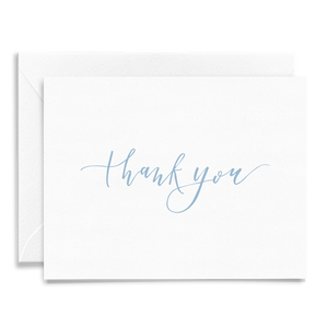Calligraphy and hand lettered Thank You folded greeting card on linen cardstock and dusty blue font