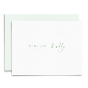 Calligraphy and hand lettered Thank You Kindly folded greeting card on linen cardstock with light green font and green envelope to coordinate