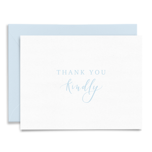 Calligraphy and hand lettered Thank You Kindly folded greeting card on linen cardstock with dusty blue font and light blue envelope to coordinate
