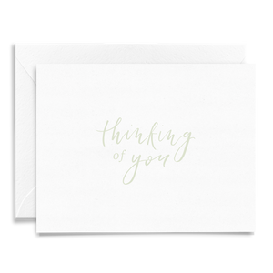 Calligraphy and hand lettered Thinking of You folded greeting card on linen cardstock with light green font, sympathy card