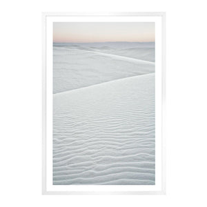 Glass Framed Wall Art. These stunning oversized sand dune photographs play with the expected tones . Each feels cool and serene with it's soft grays and subtle blush horizon.  Outside Dimensions: 18.75 x 27.75 Artist: Celement Designs