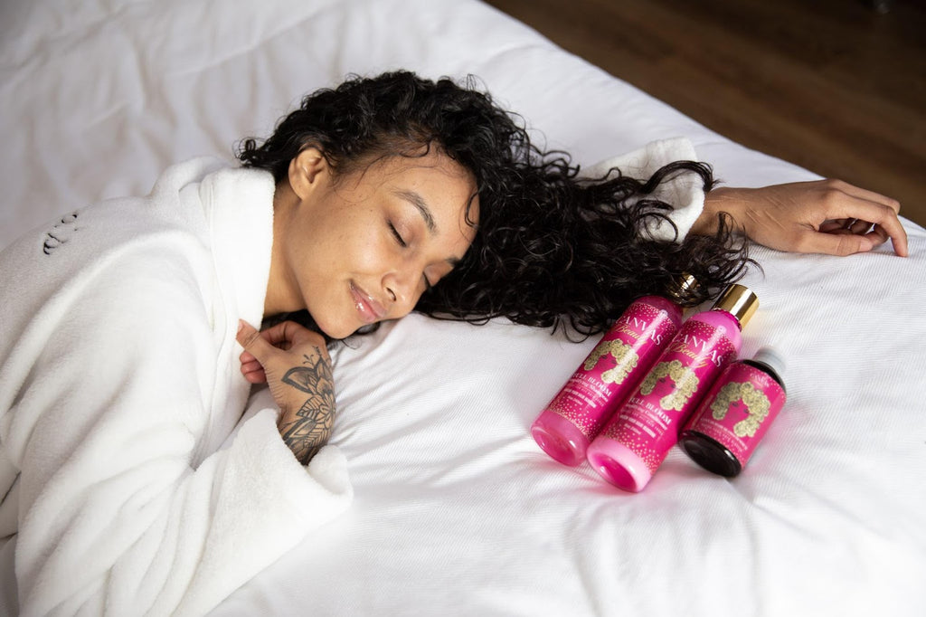 canvas girl with moisturized hair laying down on bed happy with canvas product set