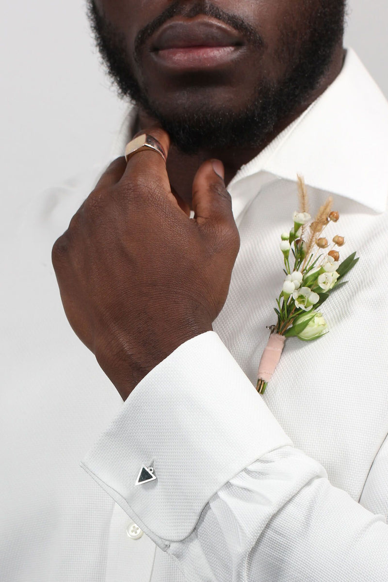 male model in wedding attire wearing Bijoux Pépine's Echo, handmade triangular cufflinks in forest green