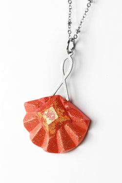 Statement long pendant chain in stainless steal and gold leaf 24 carats named Cancan and coral red resin color
