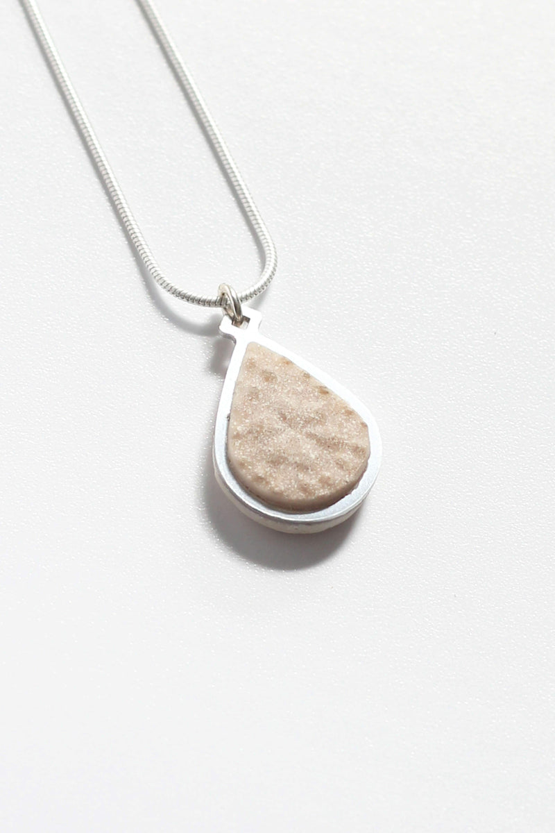 Candide teardrop adjustable length necklace in beige resin and hypoallergenic stainless steel
