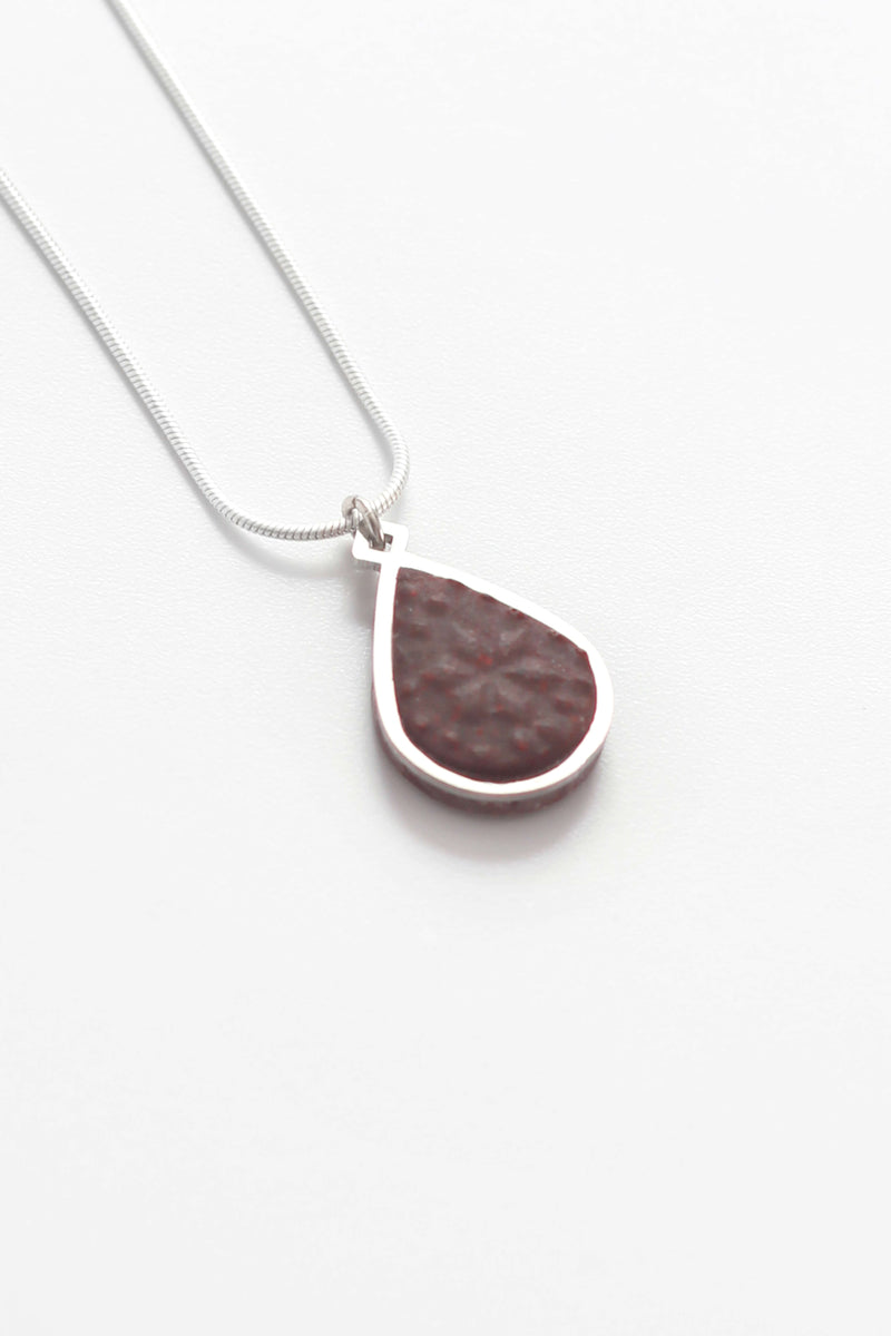 Candide teardrop adjustable length necklace in burgundy red resin and hypoallergenic stainless steel