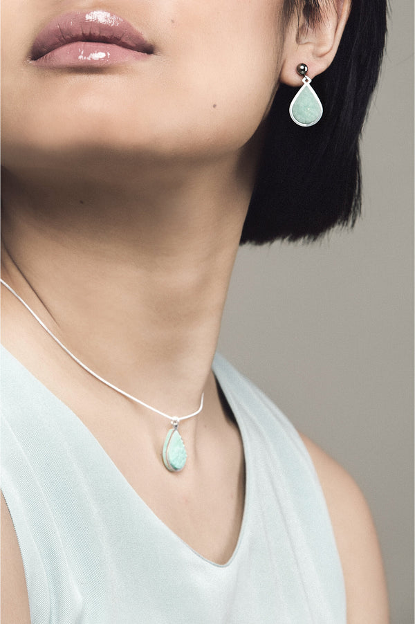 fashion model wearing matching mint green Candide teardrop stud earrings and necklace by Bijoux Pépine Montreal