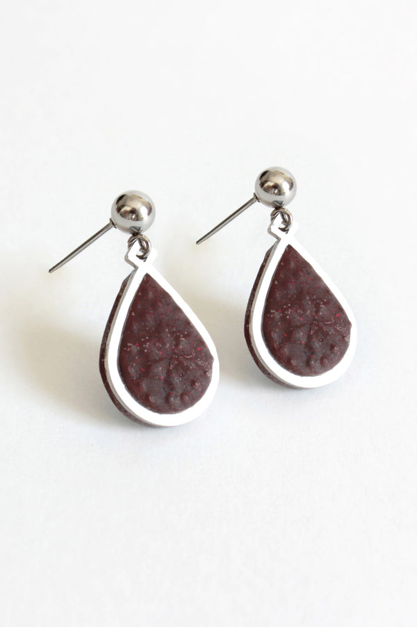 Candide teardrop stud earrings in burgundy red resin and hypoallergenic stainless steel